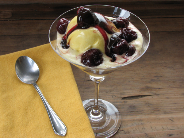 Homemade Vanilla Ice Cream with Cherries and Chocolate Sauce